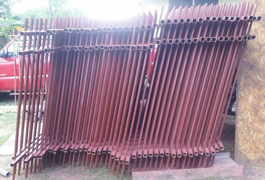 unpainted metal fence panels